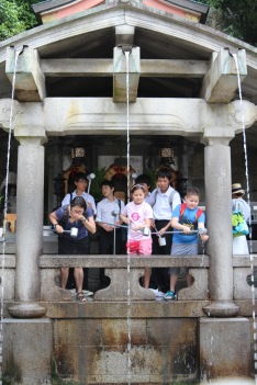 Drinking the pure waters of the Kiyomizu Temple for blessings